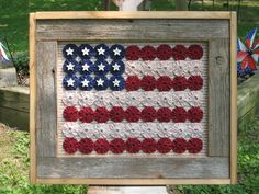 Yo-Yo flag with white star buttons on a Pledge of Allegiance background. Frame is made of recycled barn board.