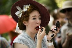 Chap Olympiad: A woman attends to her make-up as revellers gather at the Chap Olympiad. Tweed Run, Days Out, London, Elegant, Chic, Celebrities, Nest, Pictures, Costumes