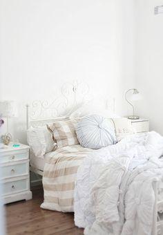 coastal style bedroom layering with white IKEA & Anthropologie bedding / comforter  abeachcottage.com