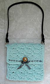 Ravelry: Easy Peasy Sandy Shells Purse pattern by Amber Schaaf