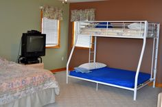 Loft bedroom with King size bed and Bunk beds with Double on bottom/Twin on top.