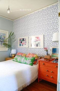 Use removable wallpaper from Chasing Paper to spruce up a bedroom accent wall.
