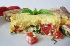 Tomato Basil Fritata - Tomatoes, fresh basil and melted mozzarella cheese surrounded by light puffy egg.