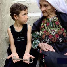 Palestinian refugees pass the keys to their lost homes to the next generation