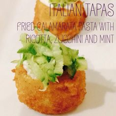 Italian tapas - fried calamarata pasta with ricotta cheese, zucchini and mint.