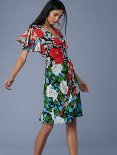 Cut in a comfortable and lightweight printed silk crepe de Chine, this knee-length, short-sleeve wrap dress is print-mixing made easy. It features flutter sleeves, a classic wrap-style closure, a V-neck, and a seam at the waist.