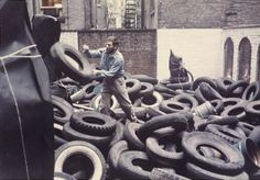 """'Yard' 1961. Martha Jackson Gallery in New York.  ALLAN KAPROW ON REINVENTIONS: """"I say reinventions, rather than reconstructions, because the works … differ markedly from their originals. Intentionally so. As I wrote in notes to one of them, they were planned to change each time they were remade. This decision, made in the late 50s, was the polar opposite of the traditional belief that the physical art object—the painting, photo, music composition, etc.—should be fixed in a permanent form."""
