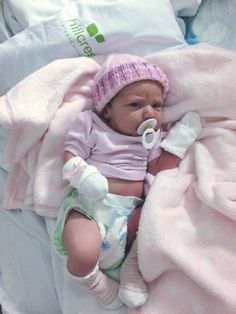 Sid's favourite photo of Nevaeh in hospital, with mittens on to stop her scratching.