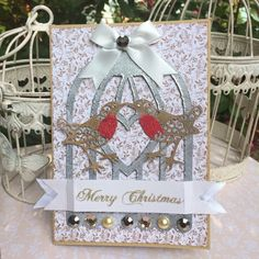 Birdcage Christmas card made using Tattered Lace wren dies which I have turned into robins using red embossing powder.