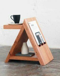 Оригинальная тумбочка интересной формы - есть полочка для чашки чая, для книжки и других вещей.
