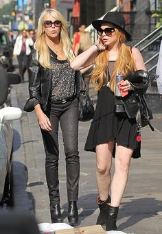 Lindsay Lohan wearing Celine New Audrey sunglasses, Rebel Yell Sail Mini dress in Black, IRO Dankin Boots in Black,  New York City October 5 2013