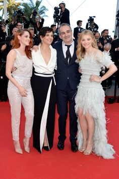 Pin for Later: Uma Thurman Shut It Down at the Cannes Closing Ceremony Chloe Moretz at the Clouds of Sils Maria Premiere Kristen Stewart, Juliette Binoche, Olivier Assayas, and Chloe Moretz in Chanel and Chopard jewelry at the Clouds of Sils Maria premiere.
