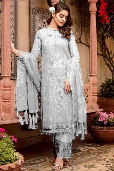 Embrace your love for fashion and inspire the rest with your uber-chic style as you wear this white georgette trouser suit which will make you absolutely astoundingly gorgeous. Straight pants has sequins and thread work. Dupatta decorated using thread and sequins work. #trousersuit #salwarkameez #malaysia #Indianwear #Indiandresses #andaazfashion Lehenga Choli, Pakistani Salwar Kameez, Eid Outfits Pakistani, Pakistani Suits Online, Eid Dresses, Indian Dresses, Trouser Suits, Trousers, Pantalon Cigarette