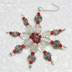 Red white and silver beaded snowflake ornament by SonomaStreet, $6.00