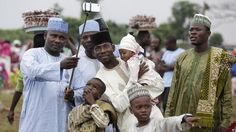 A Nigeria Muslim family takes a selfie portrait before Eid al-Fitr prayer, marking the end of the Muslim holy fasting month of Ramadan in Lagos, Nigeria, Friday, July 17, 2015.