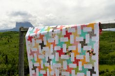 Charla MacPhee's lovely quilt, Cartwheels, photographed in front of Chief Mountain near Waterton, Alberta