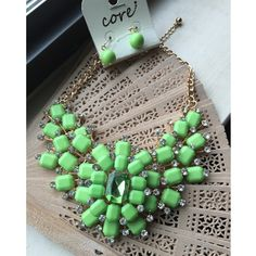 """Lime Green Statement Necklace Set Stunning boutique fashion jewelry. 3 pieces connected together with acrylic lime green """"petals"""" and rhinestones. Plastic jewel in the center. Gold tone adjustable chain. Lime green beaded earrings. New with tags. Jewelry Necklaces"""