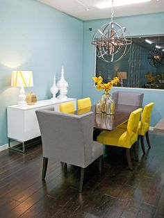 Vibrant Dining Room  The judges are in agreement: They're head-over-heels for Britany's yellow dining chairs. A gunmetal pendant adds interest over the table.