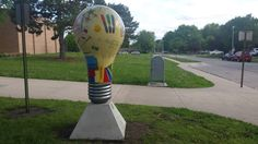 Illuminating Lincoln: Lighthouse art project.  Lightbulb titled: Lighthouse: Where Learning Comes Alive located at Zeman Elementary School 4900 S 52nd st Lincoln, Ne.  Artist:  Shelly Greeger Stoltenberg.  Sponsored by: Dave and Jane Firestone and Glen Moss and Nancy Sutton-Moss.