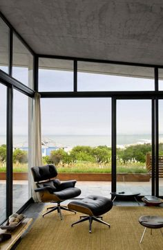 Image 9 of 27 from gallery of Psicomagia House / Martin Gomez Arquitectos. Courtesy of Estudio Martin Gomez Arquitectos Charles Eames, Luxury Interior, Interior Design, Chair And Ottoman, Modern House Design, Contemporary Furniture, Contemporary Homes, Living Spaces, Living Room