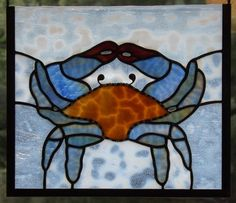 This open framed glass cutoff panel features a blue crab, a local favorite. The added detail of the unique glass cutoff gives the panel a