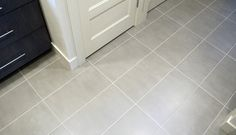 Emser tile stadium 12x24 foundation porcelain concrete stain cement grey silver modern contemporary straight stack floor tile laundry room