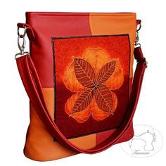 Bag is made of fine leather upholstery in color pumpkin orange and dark red, decorated with fabric panel by Robert Kaufman with autumn leaves. Leatherette are stitched and quilted in the county in an alternating style. Each seam is supported for strengthening cotton fabric strap. Czech with lining 100% cotton red with white polka dots.