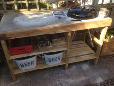Handmade bbq table with weber kettle barbeque