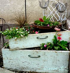 I just love what is happening over at Queen b and Me.  She has created a beautiful vignette for her porch by upcycling 2 drawers…making them into planters and then adding a few other pieces …in the end it looks totally fabulous and any porch would be graced by this whimsical creation.  I highly recommend …