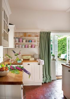 white cabinets, wood counters, French doors into garden - beautiful kitchen