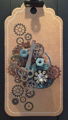 This One of a kind Steampunk brooch is made with up-cycled elements such as gears, watch parts, vintage button and jewelry findings. by Rockinrobinsbling