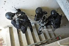 SWAT team in action ready to breach the premises