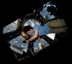 Photographing in space  (AstroSamantha)
