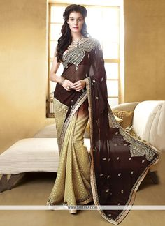 This pretty piece is a fairy tale that begins to unfold as you reveal your beauty in it. Make an adorable statement in this smashy brown georgette designer saree. This attire is beautifully adorned wi...