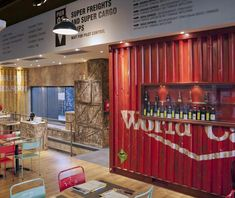 Recycled shipping containers and crates give this pizzeria industrial style appeal.
