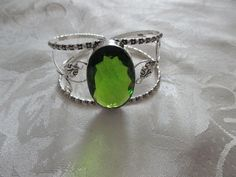 Faceted Peridot 925 silver overlay Ajustable bracelet brand new and handmade very fun to wear out on the town