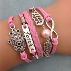 Pink angel wings faith infinity bracelet hand Infinity bracelet as pictured colors May look different on bracelet than picture shows. Sometimes it is hard to get an accurate picture. Bundle with another bracelet 2/$12. The other picture is an example of what the back looks like Jewelry Bracelets