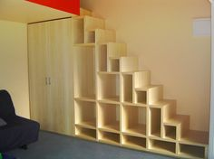 under stair bookcase. All it needs are tiny drawers and doors, a dark stain, the right hardware and you have a Japanese 'apothicary?' stair which I love.