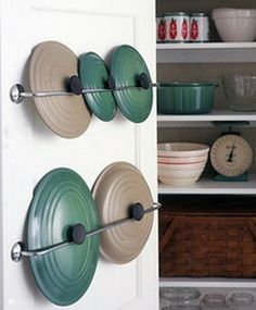 Use towel racks for lid storage