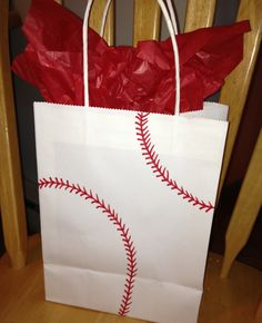 Quick and easy gift bag for a birthday or a coach. Buy a basic white bag and use red sharpie to create baseball/softball stitching. Could do yellow for softball. Baseball Treats, Baseball Coach Gifts, Baseball Mom, Baseball Cakes, Baseball Couples, Baseball Quotes, Baseball Stuff, Football, Baseball Players