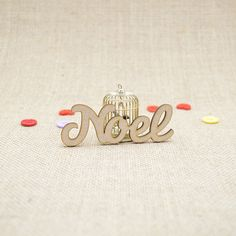 MDF wooden noel word shape laser cut from Premium 3mm MDF (Medium Density Fibreboard). Sizes from 3cm to 6cm tall in 3mm thickness.