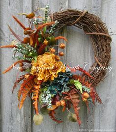 Fall Wreath, Autumn Wreaths, Thanksgiving Wreath, Harvest Decor, Elegant Fall Wreath, Fall Floral Wreath, Designer Fall Floral  Lexington Autumn Garden Wreath. An impressive collection of beautiful Hydrangeas, wildflowers and meadow grass in rich shades of antique gold, teal, copper, golden brown and avocado rest upon softly glittered ferns, set upon a rustic grapevine frame. Eye-catching and sophisticated, a stunning addition to your Fall decor.  ~A New England Wreath Company Designer…