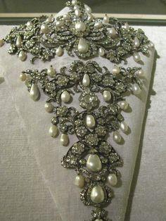 Stomacher: ca. 18th century, diamonds, pearls, precious metals. Kept in the Schatzkammer in Munich. Image from http://danaenatsis.com/author/admin/page/2/