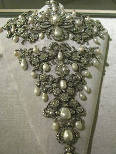Stomacher: ca. 18th century, diamonds, pearls, precious metals. Kept in the Schatzkammer in Munich. Image from http://danaenatsis.com/author/admin/page/2/
