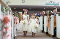 Daniel Taylor Photography.  Pew markers.  Peach ribbon
