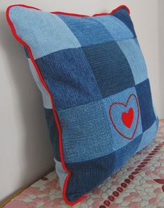Love the red piping and the beading surrounding the red heart. These would be lovely as patio/pergola cushions.