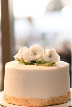 Simple wedding cake. Love the flowers placed on top.