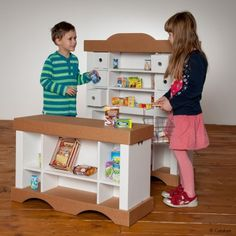 Garage en carton calafant jouets en carton construire - Construire des meubles en carton ...