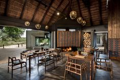 Designed for Megan Ralph Spaces for a safari lodge, our terracotta wall tiles add a striking focal point above the fire place in the dining area of this establishment.  #ceramic #wallpaper #design #interiordesign #architecture #southafrican #guesthouse #safari #decor #fireplace #tiles #wall #walltiles #featurewall #designideas #designinspo #homerenovations #hotel #renovations