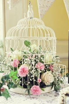I love this cage, simply because they left the door open, as they should be! #DIYHomeDecorShabbyChic